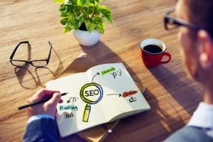 seo content marketing man with work book melbourne